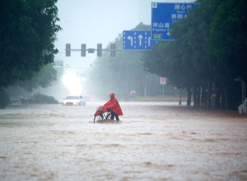QUANZHOU, Sept. 15, 2016 - A citizen walks on a waterlogged street in Quanzhou, southeast China's Fujian Province, Sept. 15, 2016. Typhoon Meranti made landfall in Xiang'an district of Xiamen City, ...