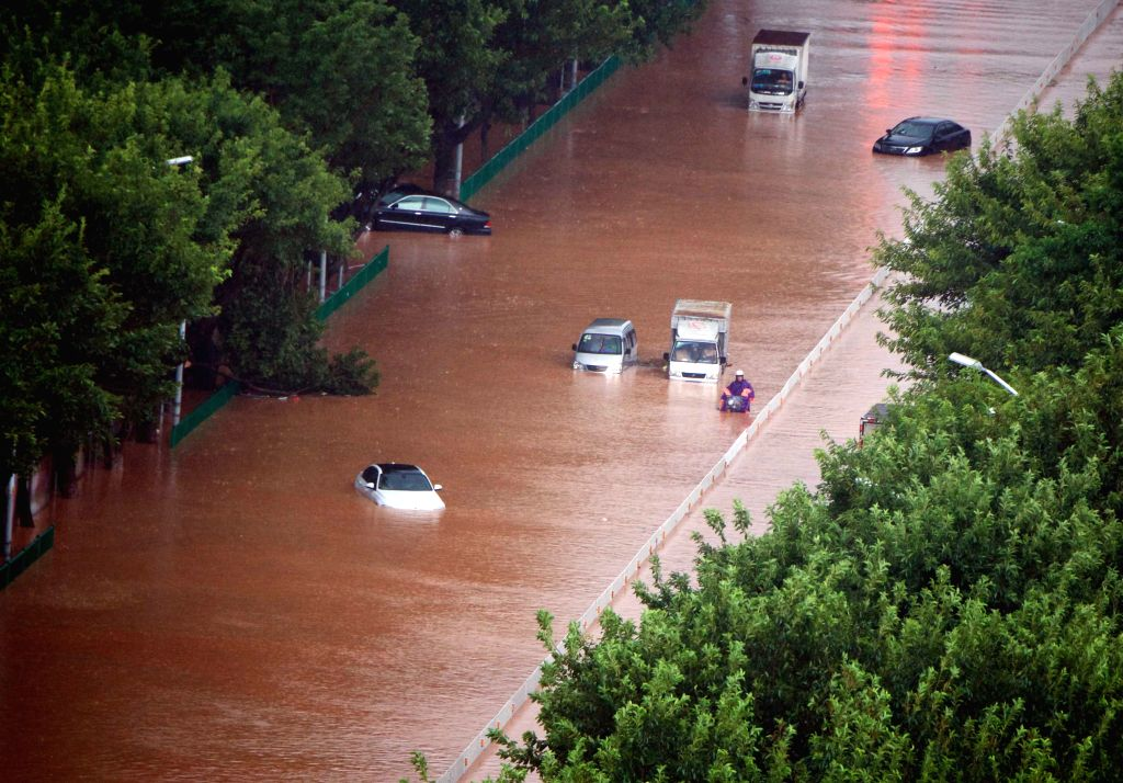 QUANZHOU, Sept. 15, 2016 - Cars are stranded on a waterlogged street in Quanzhou, southeast China's Fujian Province, Sept. 15, 2016. Typhoon Meranti made landfall in Xiang'an district of Xiamen City, ...