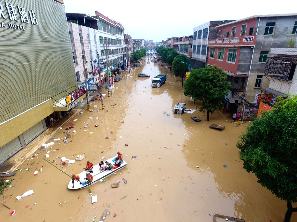 QUANZHOU, Sept. 16, 2016 - Rescuers relocate trapped local residents in Nan'an, southeast China's Fujian Province, Sept. 16, 2016. Disaster relief and reconstruction were launched after Typhoon ...