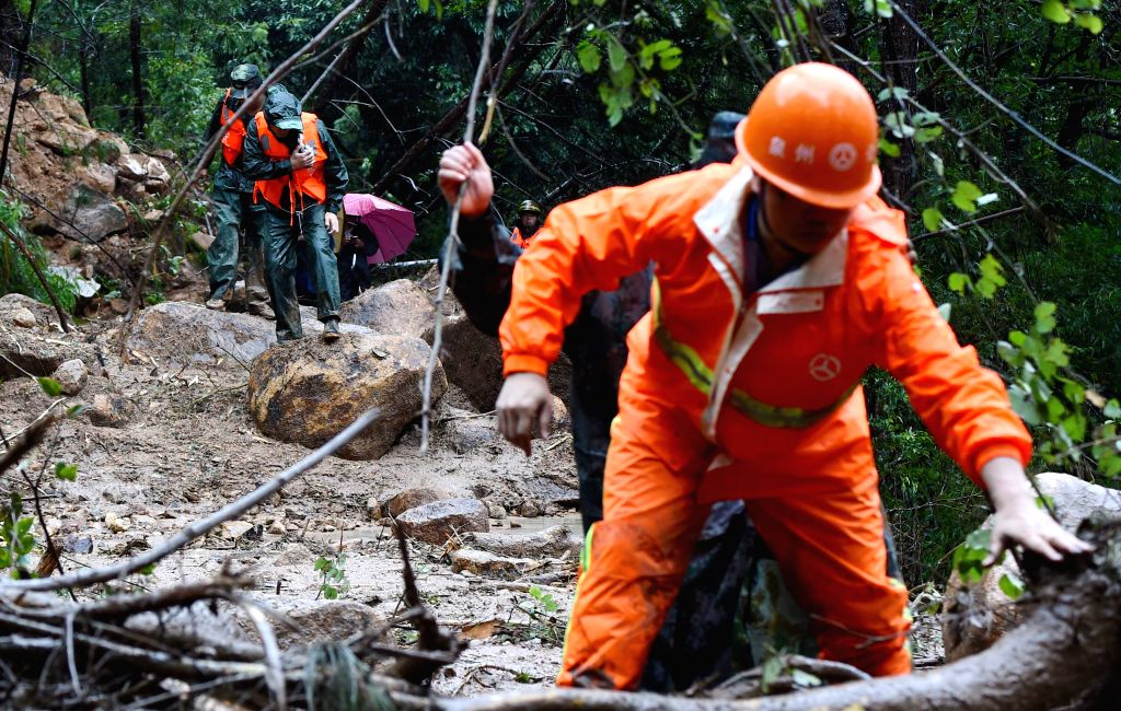 QUANZHOU, Sept. 28, 2016 - Rescuers walk on a rural road blocked by landslides in typhoon-hit Shuikou Township of Quanzhou City, southeast China's Fujian Province, Sept. 28, 2016. Typhoon Megi, the ...