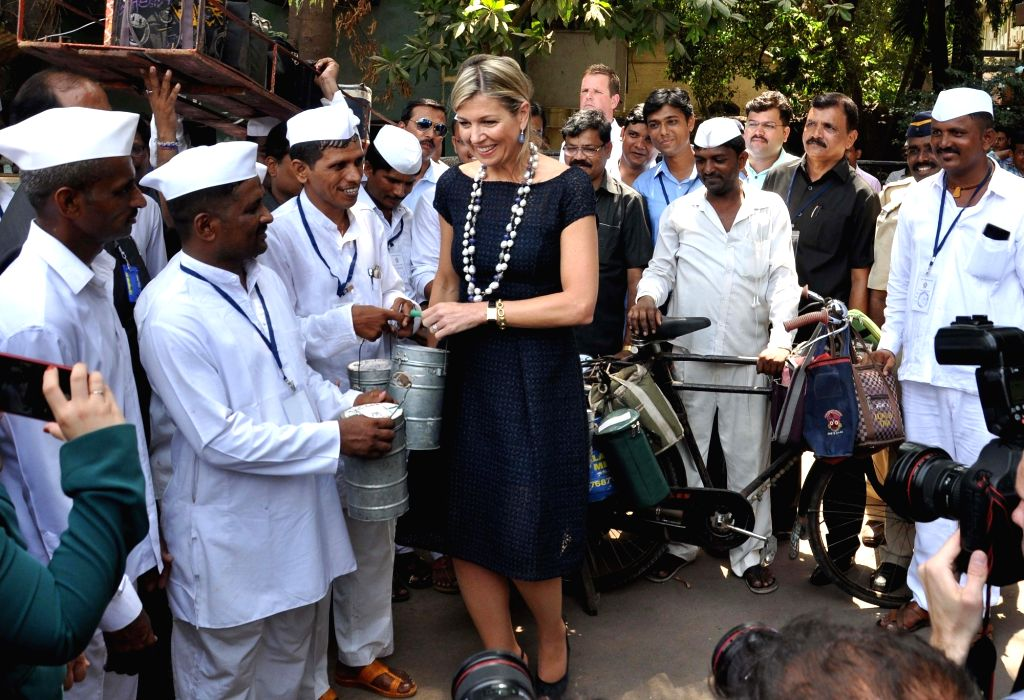 Queen Maxima of the Netherlands meets Mumbai's dabbawalas outside Andheri West station in Mumbai on May 30, 2018.