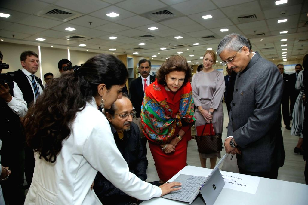 Queen Silvia of Sweden accompanied by AIIMS Director Randeep Guleria, being given a guided tour of the clinical facilities at AIIMS, during her visit to participate in a panel discussion ...