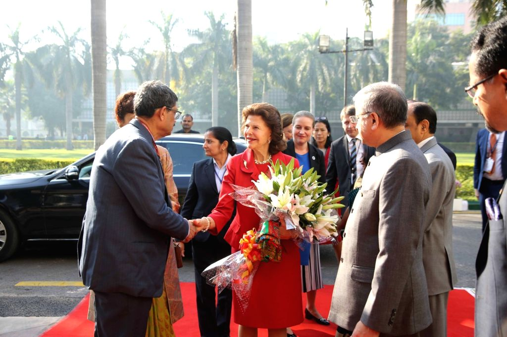 """Queen Silvia of Sweden being escorted to the venue of the panel discussion on """"Quality of life for people with dementia"""" on her arrival at AIIMS in New Delhi on Dec 3, 2019."""