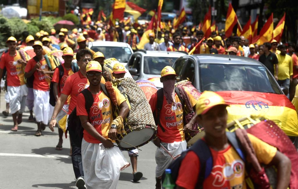 Quess East Bengal Football Club supporters participate in a rally ahead Club's centenary celebration in Kolkata on July 28, 2019.