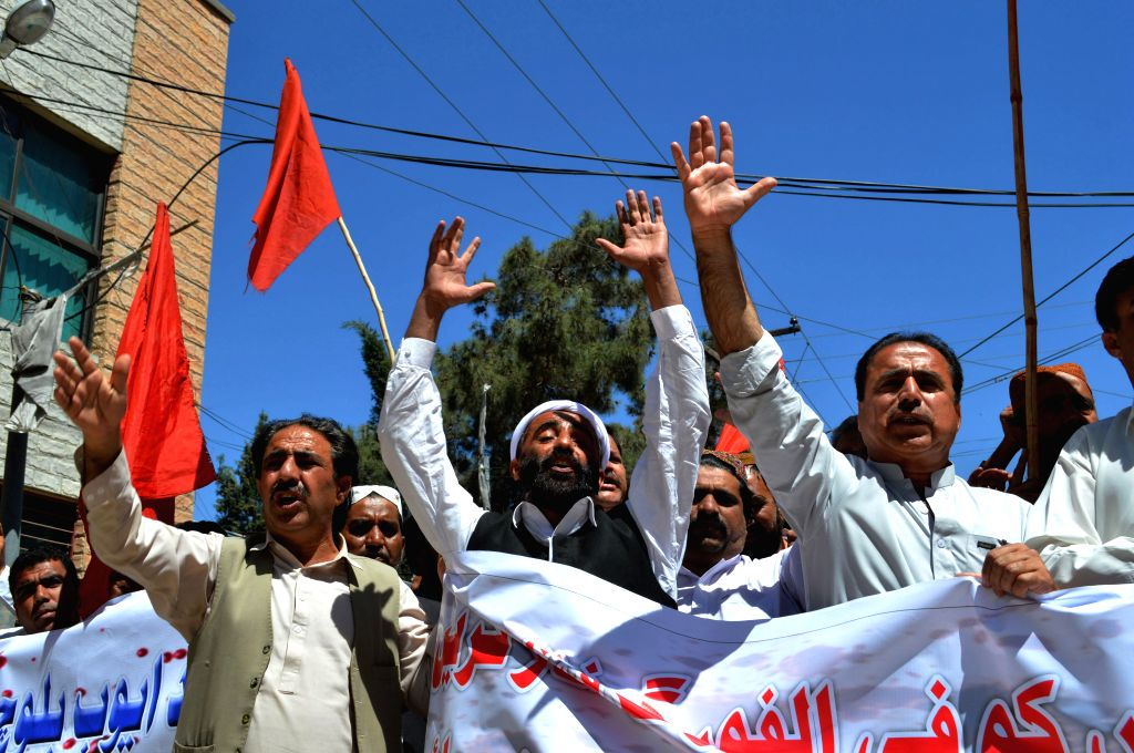 Pakistani laborers shout slogans during a protest against the killing of construction workers in an attack, in southwest Pakistan's Quetta, April 12, 2015. At least ...