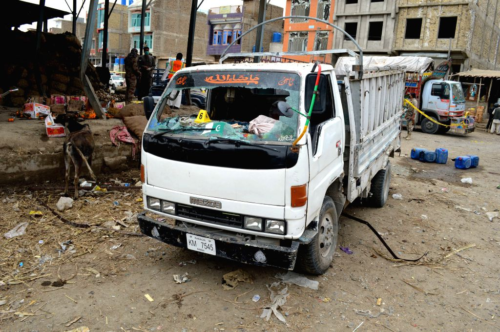 QUETTA, April 12, 2019 - A damaged vehicle is seen at the blast site in southwest Pakistan's Quetta on April 12, 2019. At least 16 people, including one security personnel and two children, were ...