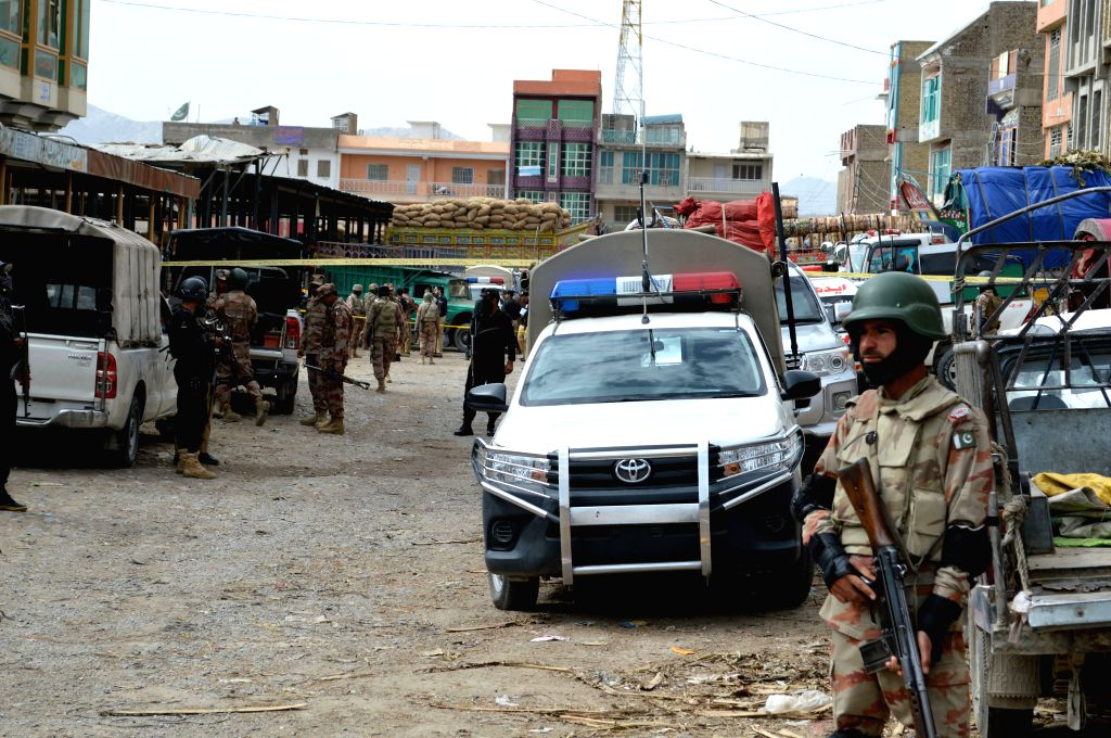 QUETTA, April 12, 2019 - Security officials inspect the blast site in southwest Pakistan's Quetta on April 12, 2019. At least 16 people, including one security personnel and two children, were killed ...