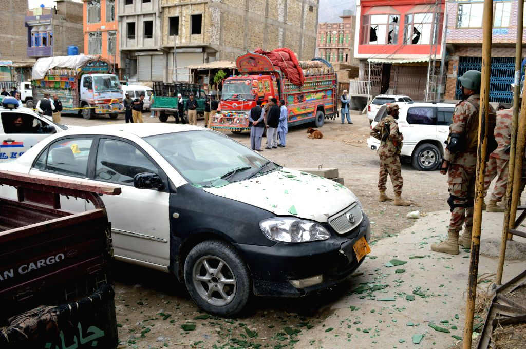 QUETTA, April 12, 2019 (Xinhua) -- Security officials inspect the blast site in southwest Pakistan's Quetta on April 12, 2019. At least 16 people, including one security personnel and two children, were killed and 30 others injured when a bomb ripped