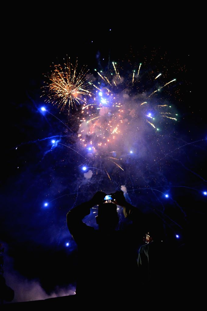 Pakistani people watch fireworks during the celebrations on Pakistan's Independence Day in southwest Pakistan's Quetta on Aug. 14, 2014.