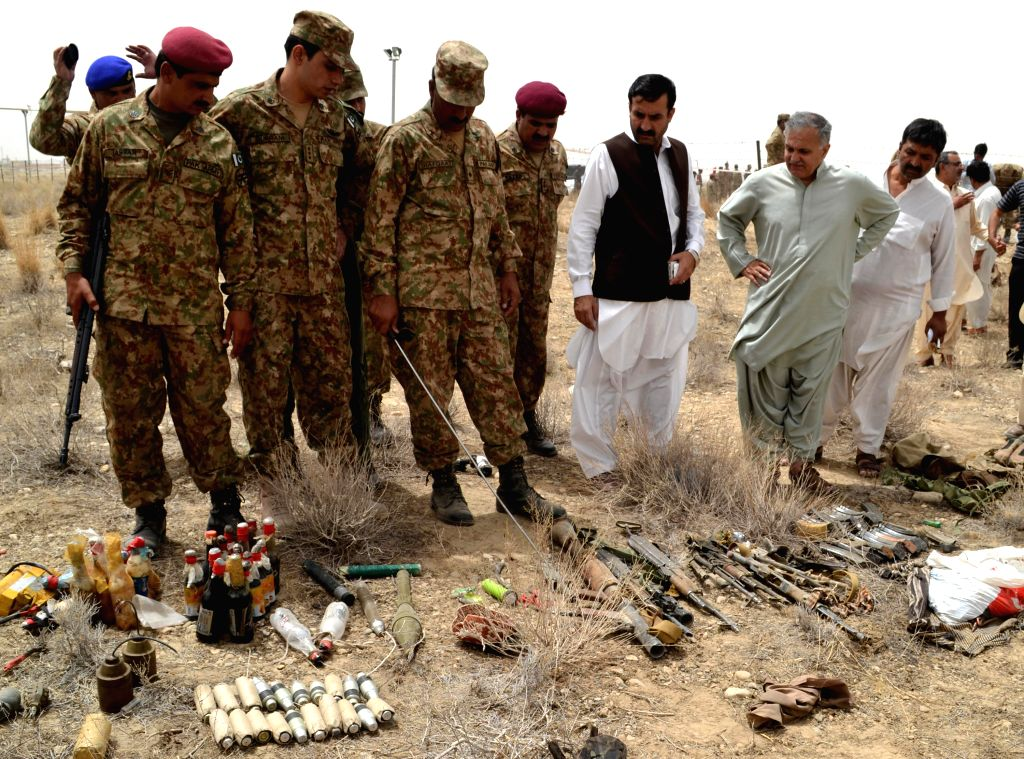 Pakistani security officials display ammunition that was recovered from militants following an attack on military airbases in southwest Pakistan's Quetta on Aug. 15,