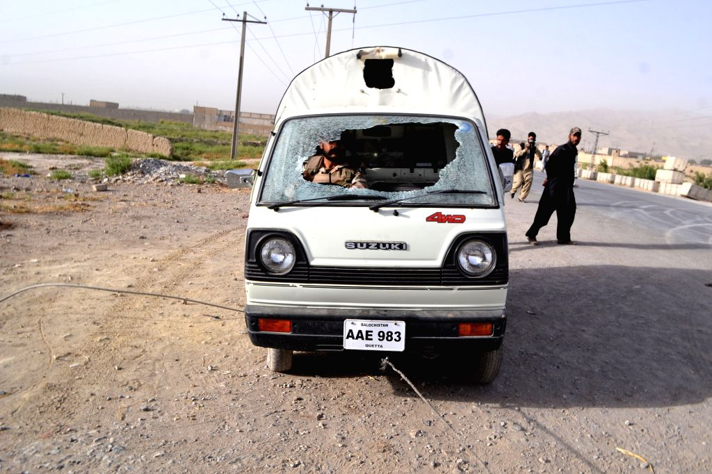 A damaged vehicle is seen following an attack by militants in southwest Pakistan's Quetta, Aug. 15, 2014. Pakistan's Air Force said Friday that highly trained ...