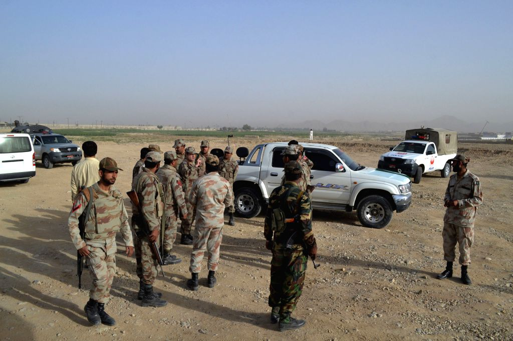 Pakistani security personnel gather near military airbases after an overnight attack by militants in southwest Pakistan's Quetta, Aug. 15, 2014. Pakistan's Air Force