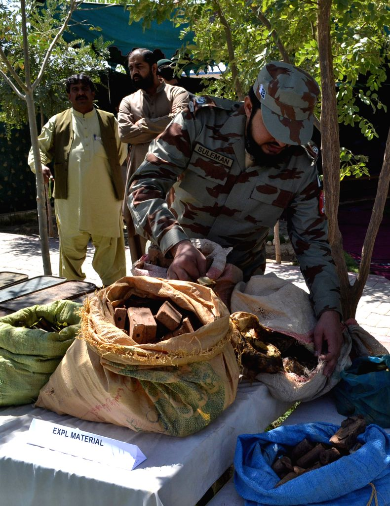 A Pakistani official displays seized explosive material to media in southwest Pakistan's Quetta, Aug. 20, 2014. Pakistani security forces seized huge amount of ...
