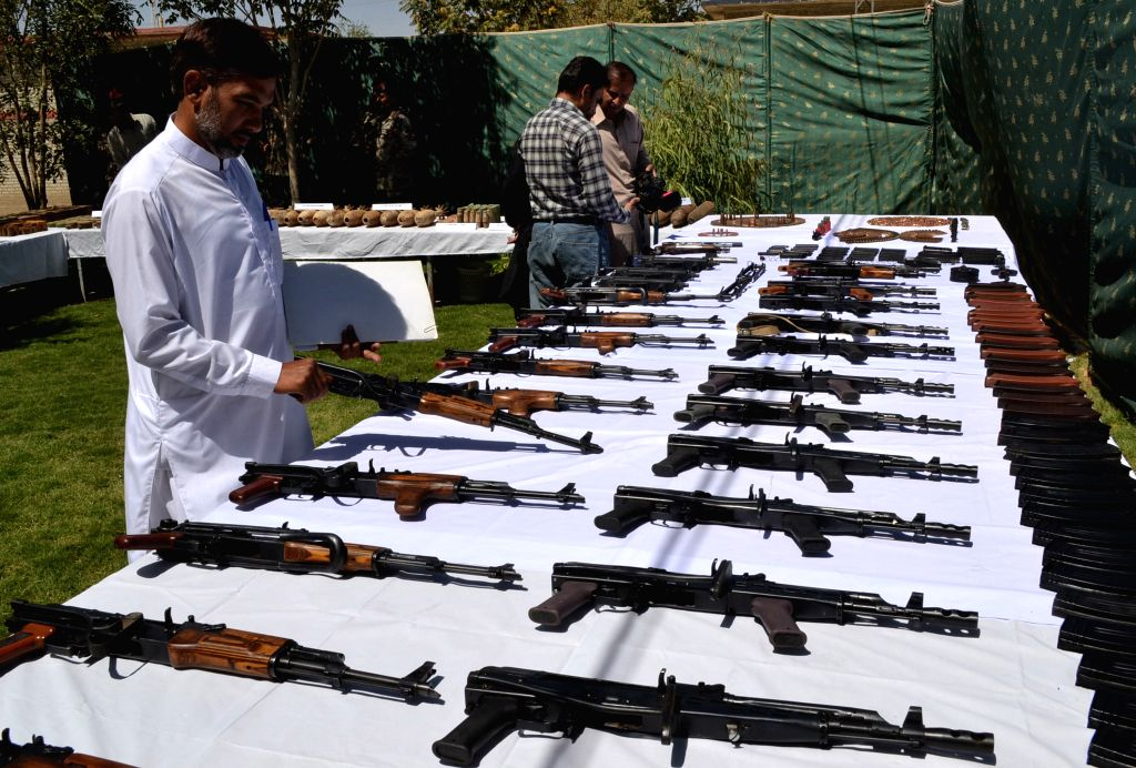 A Pakistani official displays seized hand grenades to media in southwest Pakistan's Quetta, Aug. 20, 2014. Pakistani security forces showcased huge amount of weapons