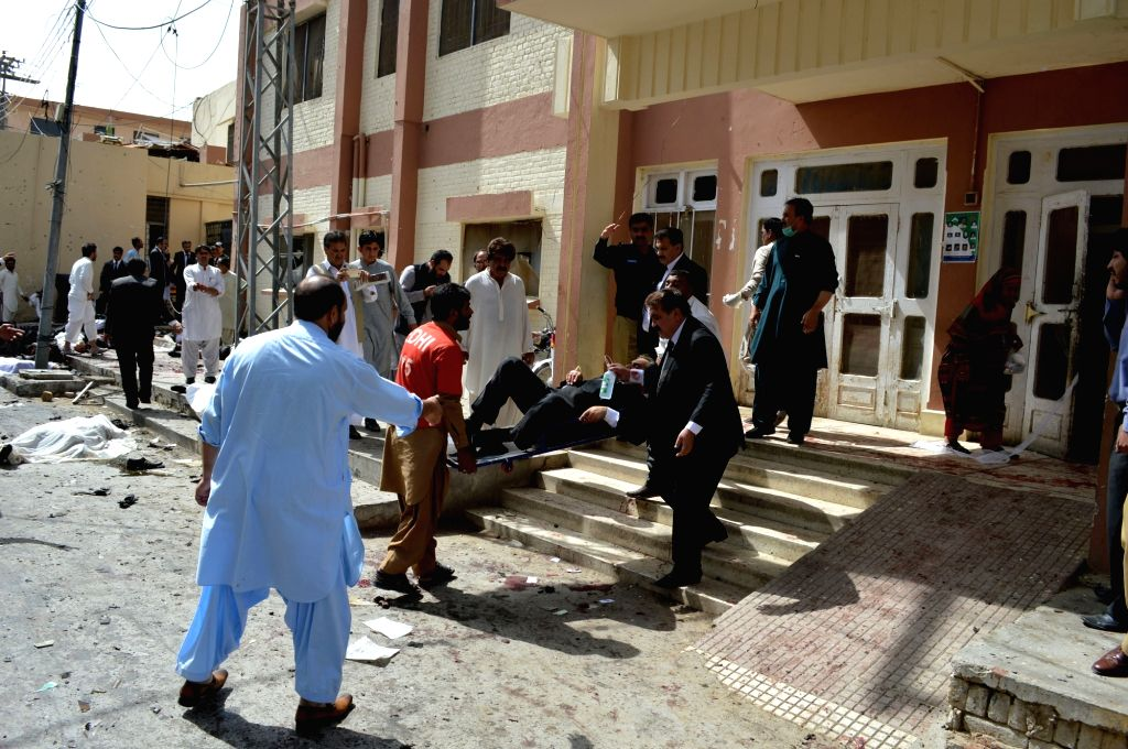 QUETTA, Aug. 8, 2016 - People transfer an injured man from the blast site in Quetta, southwest Pakistan, Aug. 8, 2016. At least 30 people were killed and 50 others injured when a blast hit a hospital ...