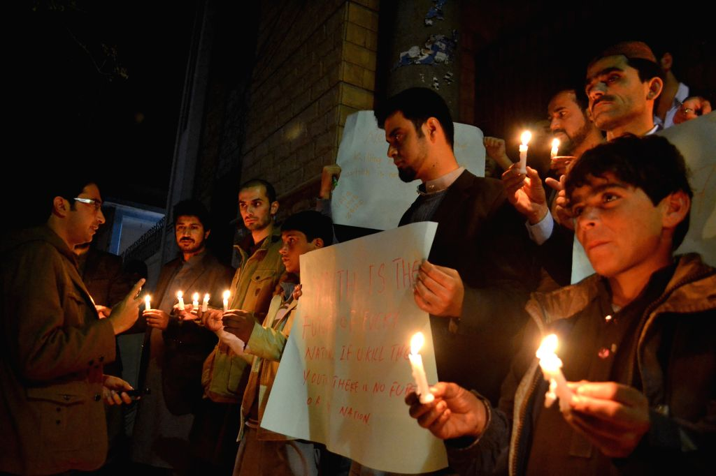 Members of Pakistani civil society light candles for the victims of an attack by militants on a school in southwest Pakistan's Quetta on Dec. 16, 2014. A total of ...