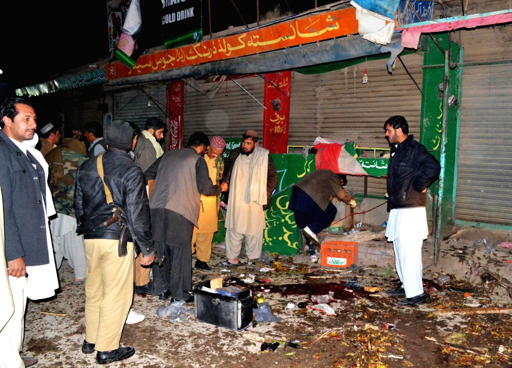 Officials examine the blast site in Quetta, southwest Pakistan, Dec. 19, 2013. At least one person was killed and 21 others including seven children were ...
