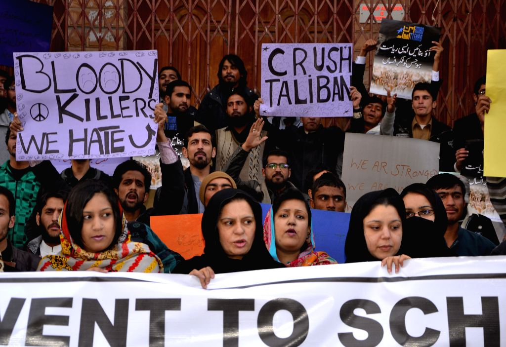 Pakistani activists participate in a rally for the victims of the Peshawar school massacre, in southwest Pakistan's Quetta on Dec. 21, 2014. At least 141 people, ...
