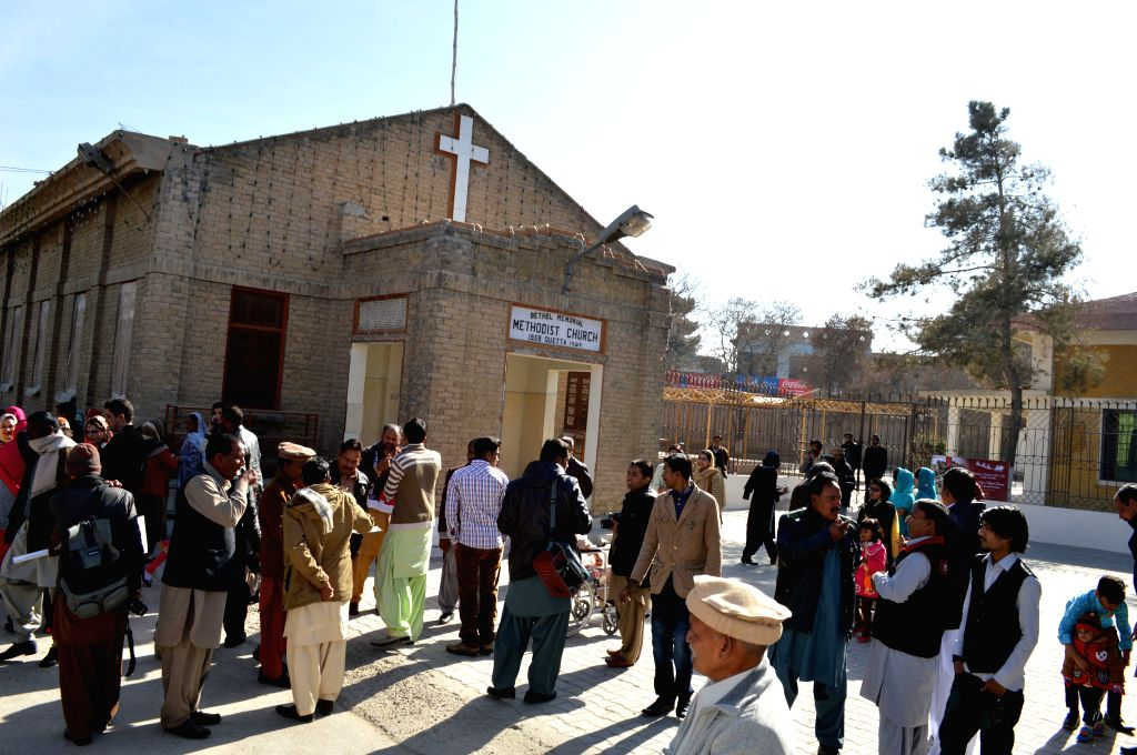 QUETTA, Dec. 25, 2015 (Xinhua) -- Pakistani Christians gather outside a church during Christmas celebrations in southwest Pakistan's Quetta, Dec. 25, 2015. Christians around the world celebrated Christmas, a holiday commemorating the birth of Jesus C