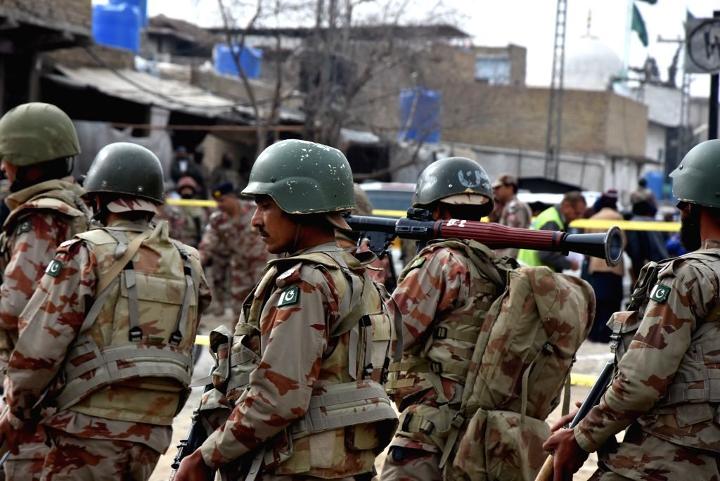 QUETTA, Feb. 14, 2018 - Security officials gather at the attack site in southwest Pakistan's Quetta on Feb. 14, 2018. At least four security personnel were killed when some unknown miscreants ...