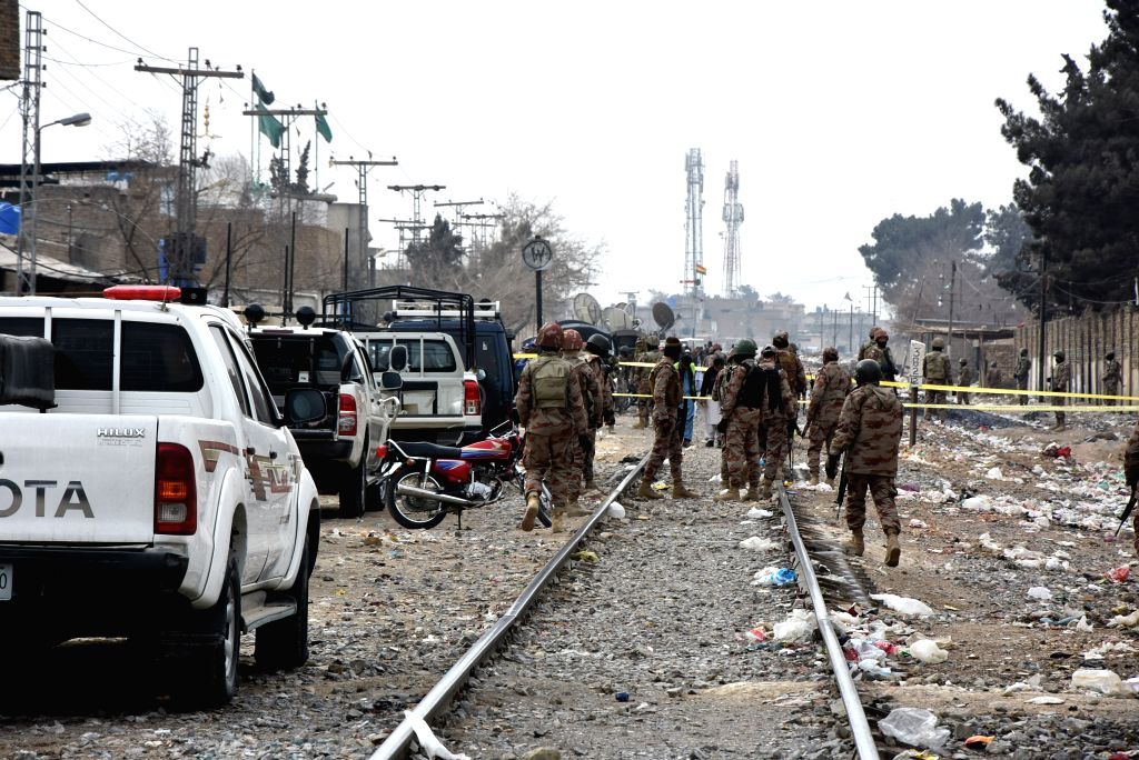QUETTA, Feb. 14, 2018 - Security officials inspect the attack site in southwest Pakistan's Quetta on Feb. 14, 2018. At least four security personnel were killed when some unknown miscreants ambushed ...