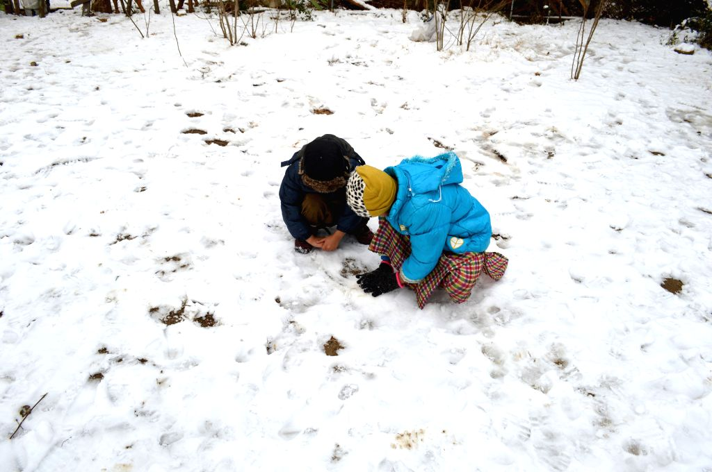 QUETTA, Jan. 14, 2017 - Children play snow in southwest Pakistan's Quetta, Jan. 14, 2017.