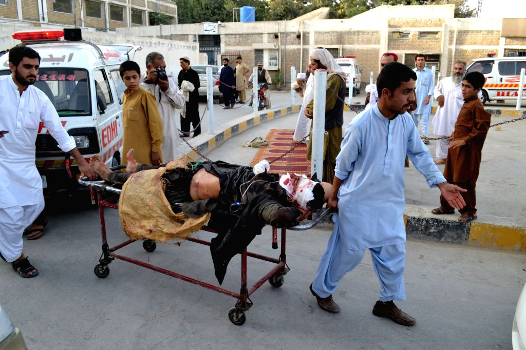 People transfer an injured man to a hospital in southwest Pakistan's Quetta on July 27, 2014. At least one person was killed and 13 others injured as a bomb blast ...