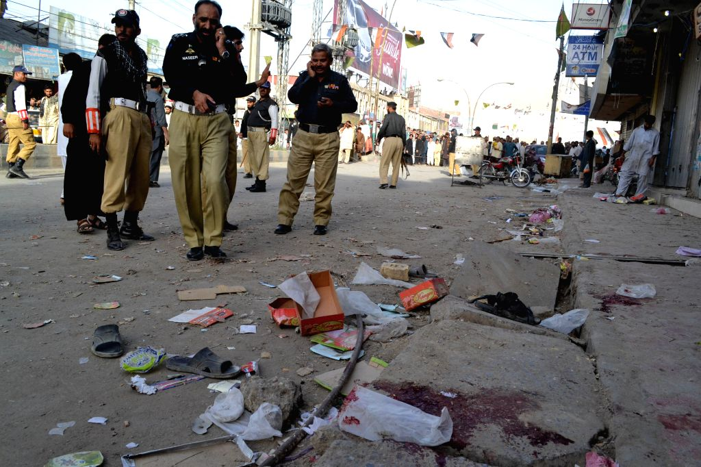 Policemen inspect the bomb blast site in southwest Pakistan's Quetta on July 27, 2014. At least one person was killed and 13 others injured as a bomb blast hit a ...