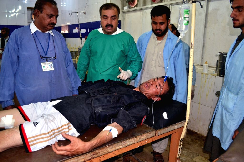 QUETTA, June 23, 2017 - An injured man receives medical treatment at a hospital following a suicide blast in southwest Pakistan's Quetta, on June 23, 2017. At least 11 people including five policemen ...
