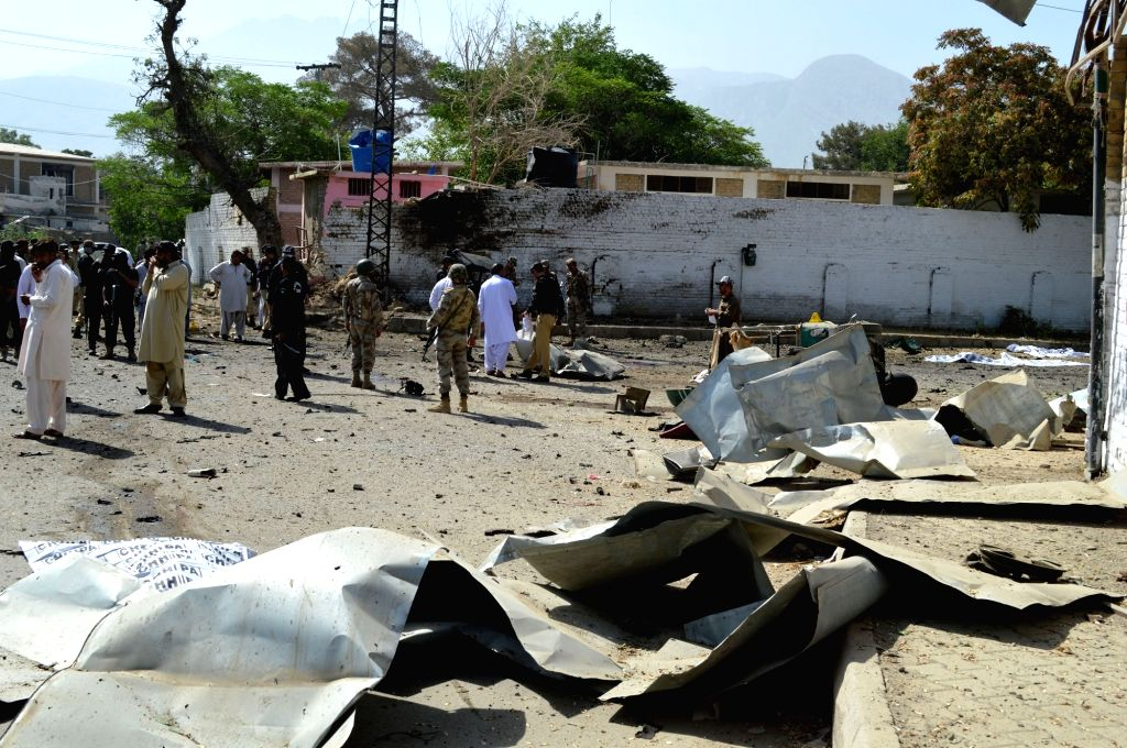 QUETTA, June 23, 2017 - Security officials stand guard at the blast site in southwest Pakistan's Quetta, on June 23, 2017. At least 11 people including five policemen were killed and 20 others ...