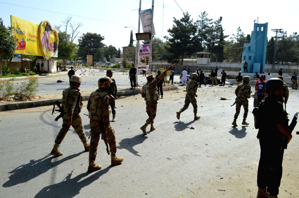 QUETTA, June 23, 2017 - Soldiers arrive at a blast site in southwest Pakistan's Quetta, on June 23, 2017. At least 11 people including five policemen were killed and 20 others injured including two ...