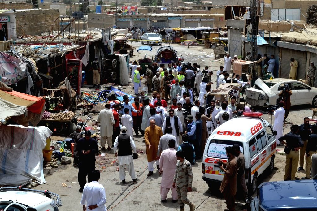 QUETTA, June 24, 2016 - People gather at a blast site in southwest Pakistan's Quetta, June 24, 2016. At least three people were killed and 27 others injured as a bomb blast hit Quetta on Friday, ...