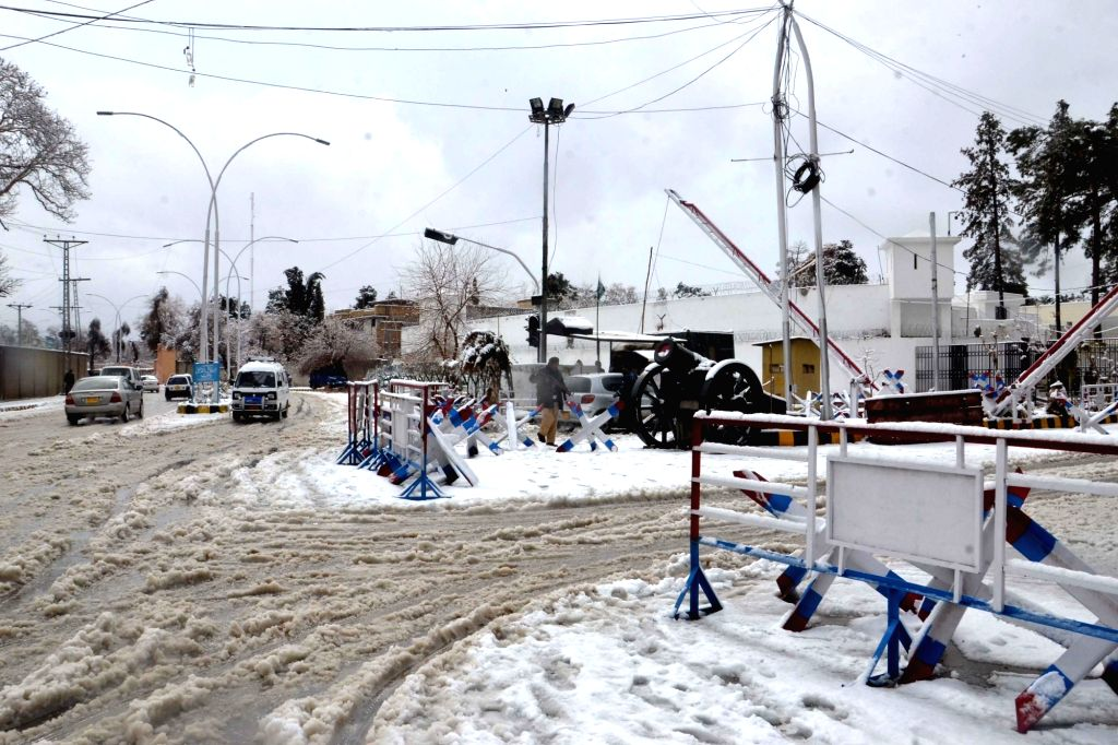QUETTA, March 2, 2019 - Vehicles run on a snow-covered road after a heavy snowfall in southwest Pakistan's Quetta on March 2, 2019.