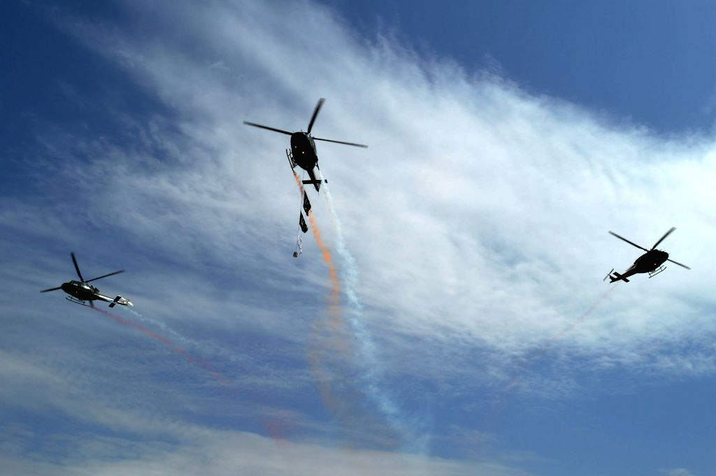 Pakistani army helicopters fly over during a rehearsal for the upcoming Pakistan Day celebrations in southwest Pakistan's Quetta on March 22, 2015. On March 23, ...