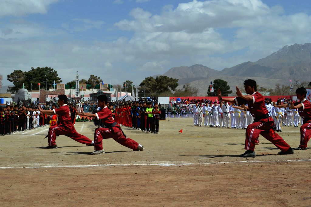 Pakistani athletes perform during the opening ceremony of Balochistan Sports Festival in southwest Pakistan's Quetta, March 22, 2015.