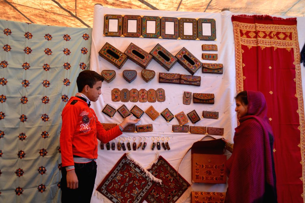 Pakistani people visit a stall at a traditional exhibition in southwest Pakistan's Quetta on March 26, 2015.