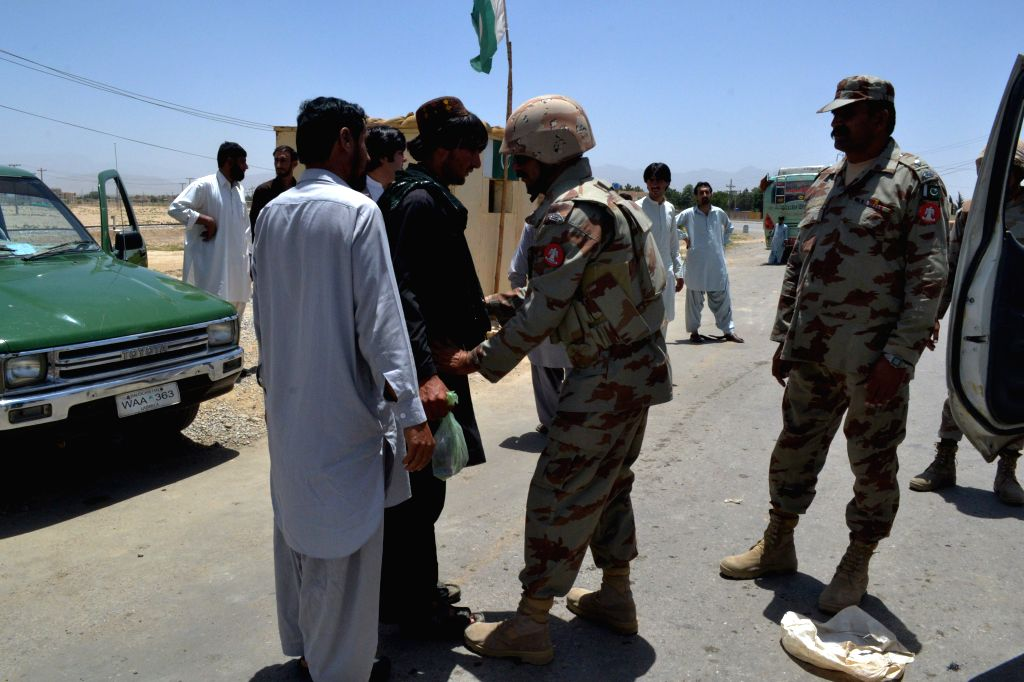 Pakistani security officials frisk a man on a road due to security high alert in southwest Pakistan's Quetta, March 26, 2015.