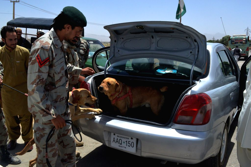 Pakistani security officials check a vehicle on a road due to security high alert in southwest Pakistan's Quetta, March 26, 2015.