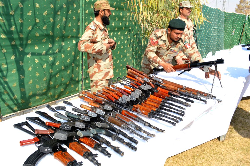 Pakistani security officials display seized weapons in southwest Pakistan's Quetta, on March 6, 2015. Frontier Corps (FC) on Friday foiled terror bids planned for ...