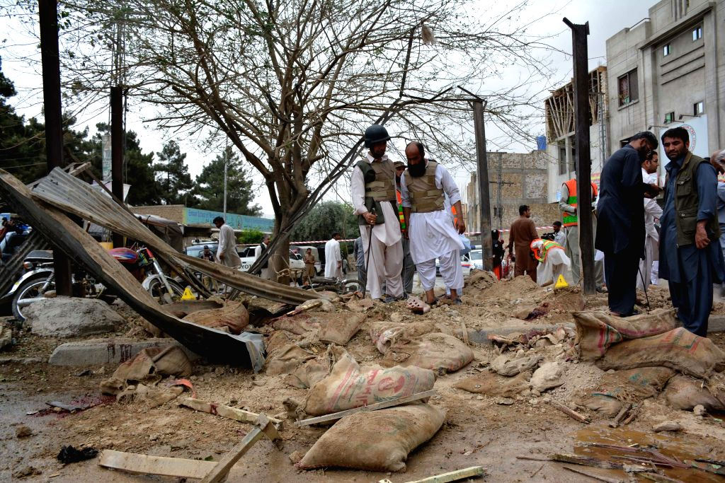 QUETTA, May 10, 2016 - Security officials inspect the explosion site in southwestern Pakistan's Quetta on May 10, 2016. At least 2 policemen were killed and 11 others injured when a blast hit a ...