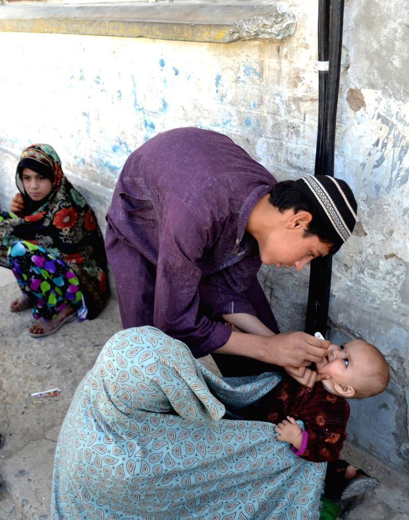A Pakistani medical worker gives polio vaccine drops to a child in southwest Pakistan's Quetta, May 13, 2014. Pakistan will set up mandatory immunization points at ...