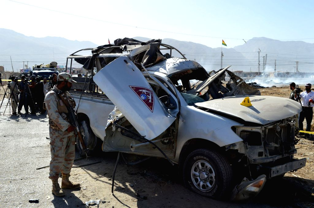 QUETTA, May 19, 2016 - A Pakistani soldier stands guard besides a destroyed police vehicle at the blast site in Quetta, southwest Pakistan, May 19, 2016. At least one policeman was killed and five ...