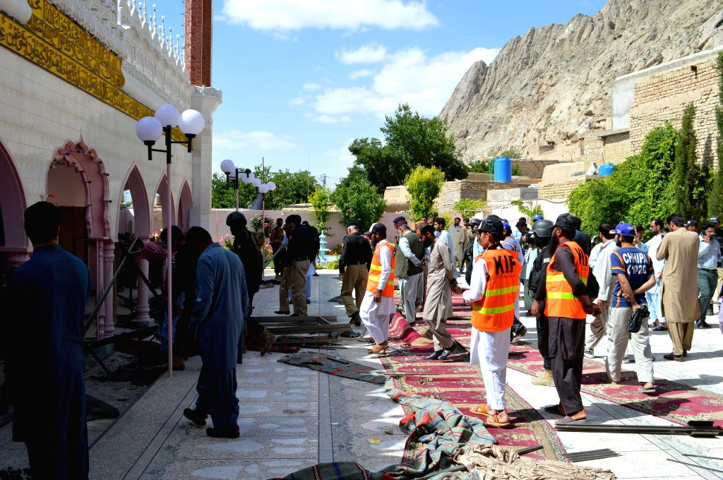 QUETTA, May 24, 2019 - Security officials examine the blast site at a mosque in southwest Pakistan's Quetta on May 24, 2019. At least two people were killed and 25 others injured when an explosion ...