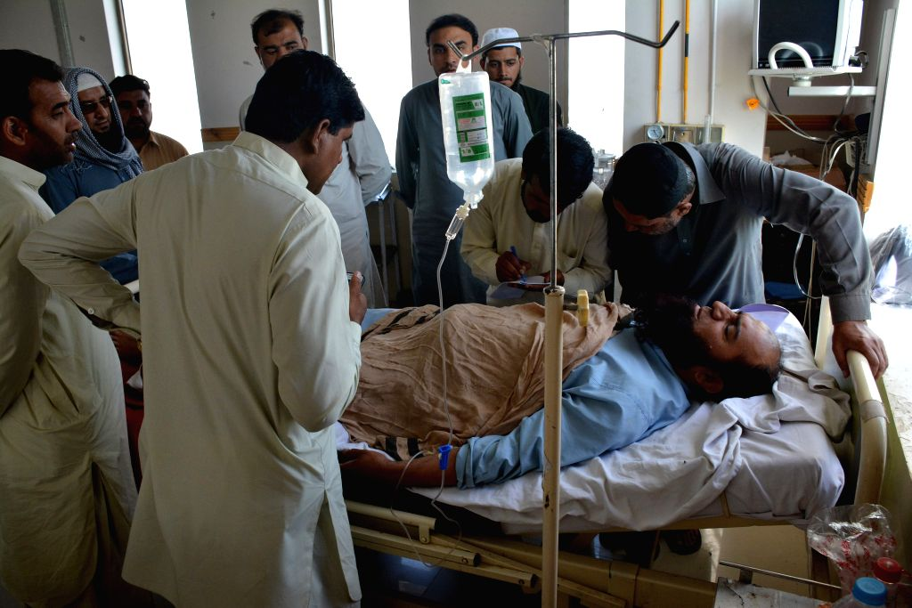 QUETTA, May 25, 2017 - A Pakistani man injured during the kidnapping of two Chinese, receives medical treatment at a hospital in the neighborhood of Jinnah town in southwest Pakistan's Quetta, May ...