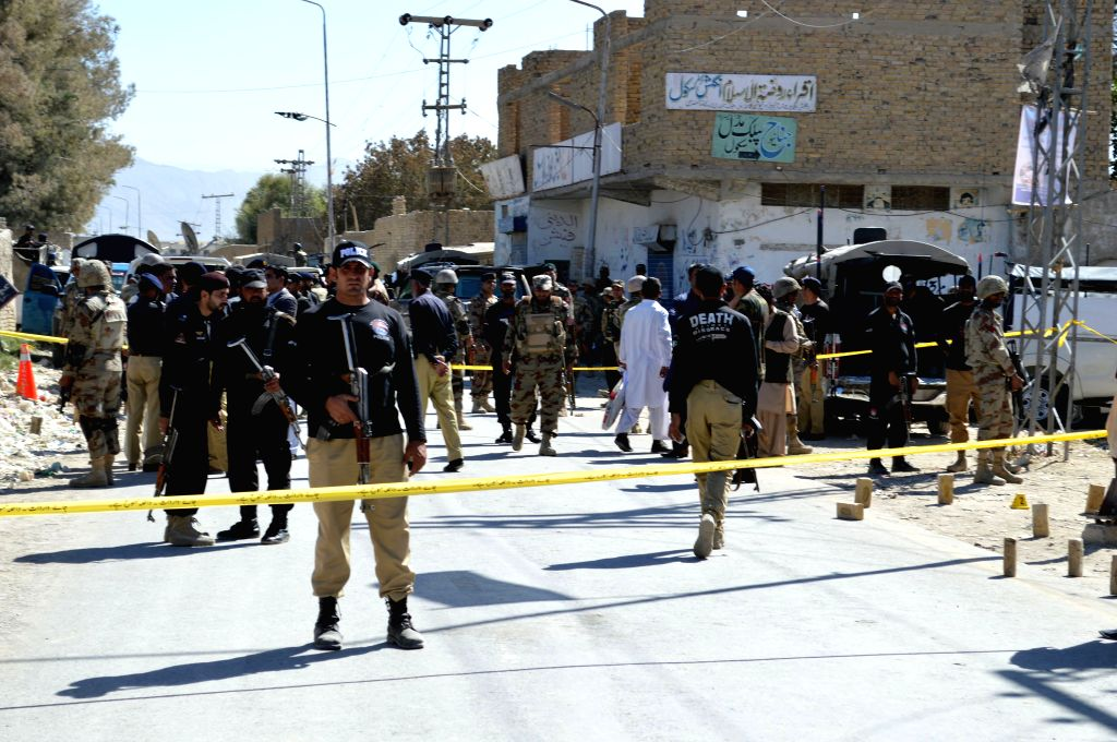 QUETTA, Oct. 14, 2016 - Policemen stand guard at the site of a gunmen attack in southwest Pakistan's Quetta, Oct. 14, 2016. At least three paramilitary officers were killed when unknown gunmen riding ...
