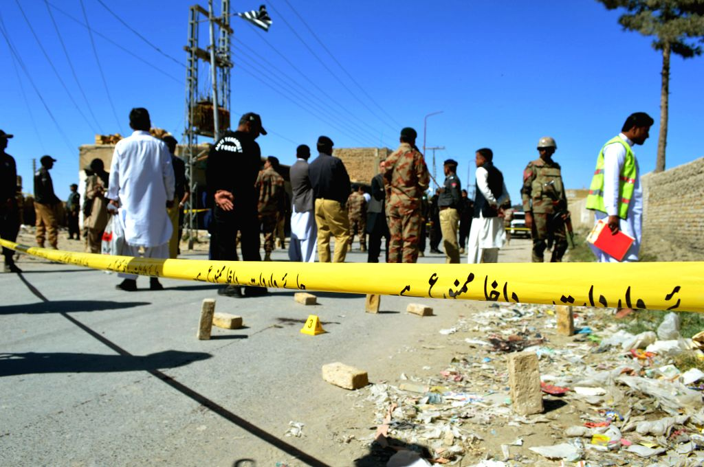 QUETTA, Oct. 14, 2016 - Security forces cordon off the site of a gunmen attack in southwest Pakistan's Quetta, Oct. 14, 2016. At least three paramilitary officers were killed when unknown gunmen ...