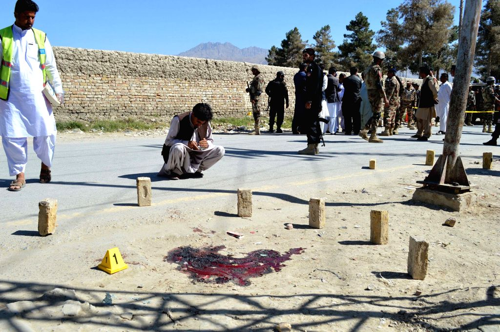 QUETTA, Oct. 14, 2016 - Security officials examine the site of a gunmen attack in southwest Pakistan's Quetta, Oct. 14, 2016. At least three paramilitary officers were killed when unknown gunmen ...