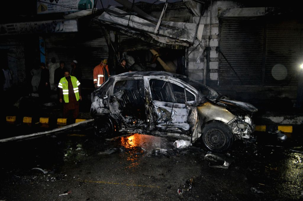 QUETTA, Oct. 16, 2019 - A damaged car is seen at the blast site in Quetta, Pakistan, Oct. 15, 2019. One policeman was killed and 10 others were injured when a roadside bomb hit a police vehicle in ...