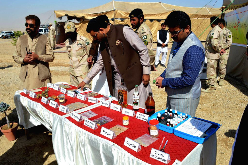 QUETTA, Oct. 20, 2016 - Pakistani officials show seized drugs and alcohol to media during a ceremony in southwest Pakistan's Quetta on Oct. 20, 2016. About 252 tons of drugs including heroin, ...