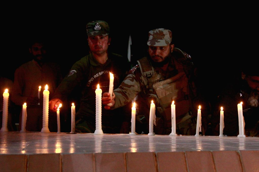 QUETTA, Oct. 29, 2016 - Pakistani soldiers light candles in memory of the cadets killed at the Police Training College attack, in southwest Pakistan's Quetta on Oct. 29, 2016. At least 60 people were ...